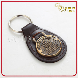 Oval Shape Antique Gold Embossed Metal & Leather Key Fob